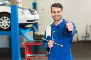 Smiling mechanic looking at camera