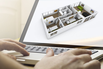 planning home renovation on a laptop