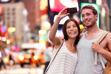 Couple taking smartphone selfie in New York, NYC