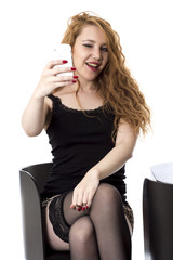 Model Released. Young Woman Using Mobile Telephone