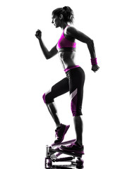 Fototapete - woman fitness stepper  exercises silhouette