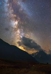 Foto op Aluminium Koraal Milky Way over mountains