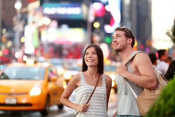 Times Square couple travel in New York City NYC