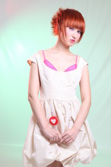 girl in satin dress with candy heart