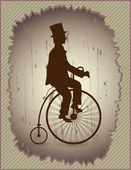 Gentleman sitting on the bike and riding forward.