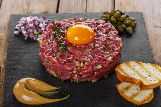 Beef tartare with capers yolk and mustard