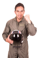 young male hispanic pilot holding helmet