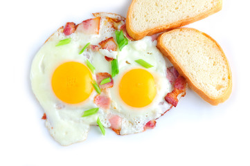 Two fried eggs and bacon