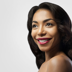 Smiling black girl with perfect skin and makeup.