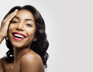 Smiling black girl with perfect skin and makeup