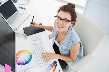 Smiling designer using computer and digitizer