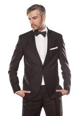 handsome man in black jacket posing on white