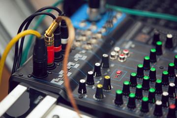 Close-up of audio mixing desk. Selective focus