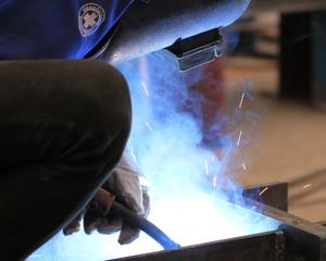 welder is welding the steel plate