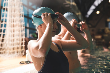 Two swimmers preparing to race at the swimming pool.