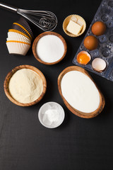 baking ingredients on dark. yogurt, semolina, eggs & butter. kit
