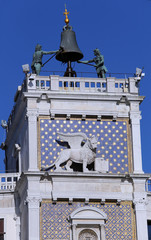 venice clock tower with blackened statues and lion