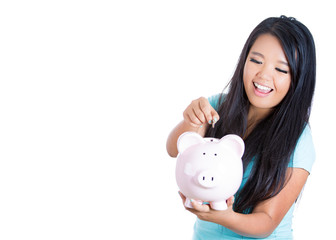 Young woman with piggy bank isolated on white background