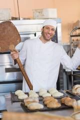 Happy baker smiling at camera