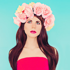 Sensual brunette lady with floral wreath on her head. Roses, Spr
