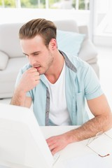 Concentrated businessman typing on keyboard