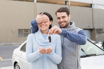 Young man about to surprise girlfriend with new car