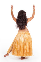 Young hula dancer seen from behind