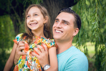 Portrait of a happy man and a beautiful little girl