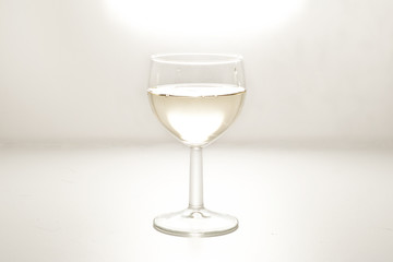 wine in a glass on white background