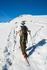 Alpine touring towards the summit