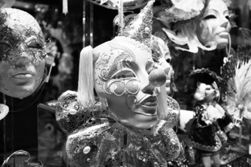 Various carnival masks on sale on a wall in a shop