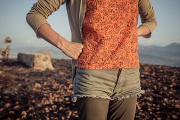 Woman standing in barren landscape