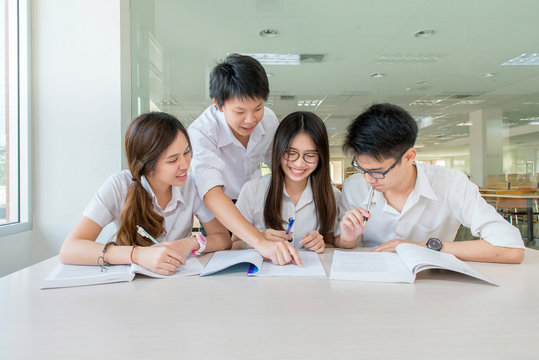 Group of asian students in uniform studying together at classroo