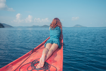 Woman on the bow of small boat