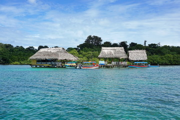 Tropical restaurant with thatched roof over water