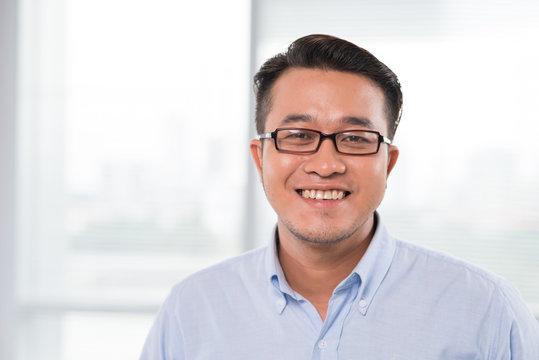 Smiling Vietnamese man in glasses
