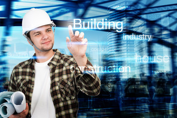 Young engineer pointing at building and construction concept