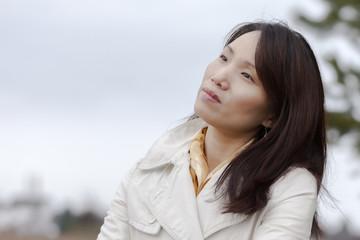 Korean woman enjoys the weather.