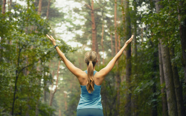 healthy lifestyle fitness sporty woman early in forest area
