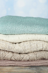 Knitting clothes on light background