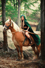 sexy girl elf with a bow on horseback
