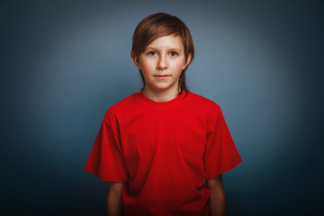 European-looking boy of ten years portrait on gray background re