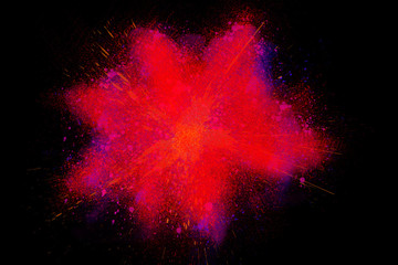 Freeze motion colorful powder paint exploding black background