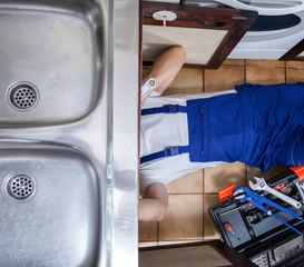Handyman lies on the floor
