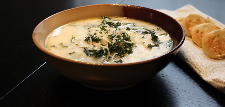 Zuppa toscana soup with sliced baguette