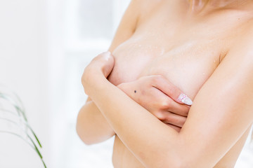Woman holding her breast