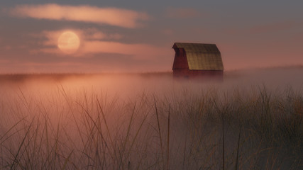 Old agricultural barn in a misty field