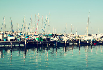 romantic marina with yachts. retro filtered image