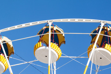 Part of Ferris wheel on a clear day
