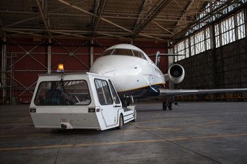 Business jet airplane stays in hangar.